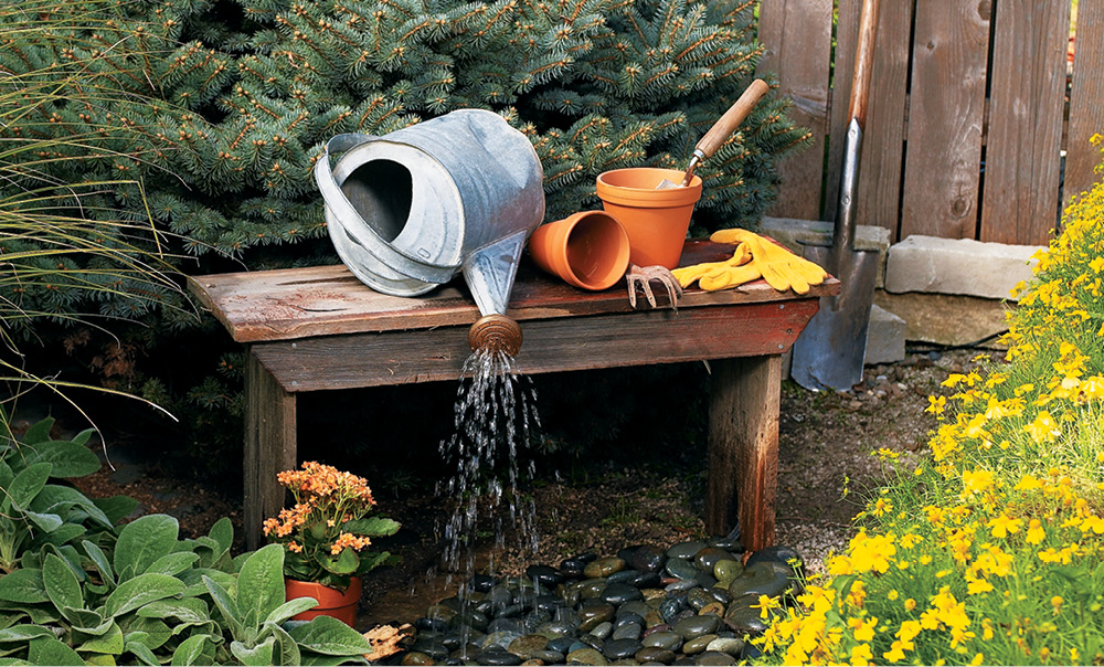 Build an outdoor water feature my home my style for Garden feature ideas